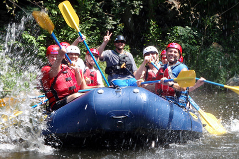 A group of people enjoy an exhilarating white water rafting adventure from Big Creek Expeditions in Tennessee, which is available for free to guests staying at Xplorie participating properties.