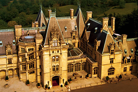 An aerial view of the historic Biltmore Estate building in Asheville, North Carolina, where Xplorie participating properties offer guests free admission.