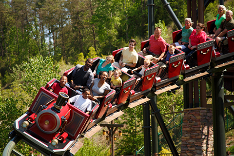 Guests enjoying a thrilling roller coaster ride at Dollywood Theme Park in Pigeon Forge, Tennessee, where guests staying at Xplorie participating properties can enjoy a free one-day ticket.