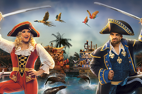 Two pirate captains face off during the exciting Pirates Voyage Dinner & Show in Pigeon Forge, Tennessee, where guests staying at Xplorie participating properties can enjoy a free admission.