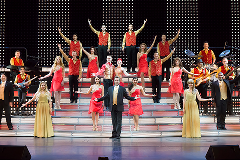 The Smoky Mountain Opry preforming onstage in Pigeon Forge, Tennessee, where guests staying at Xplorie participating properties can enjoy a free admission.