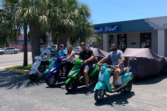 A group of friends enjoying the two hour scooter rental from Beach Blast Rentals